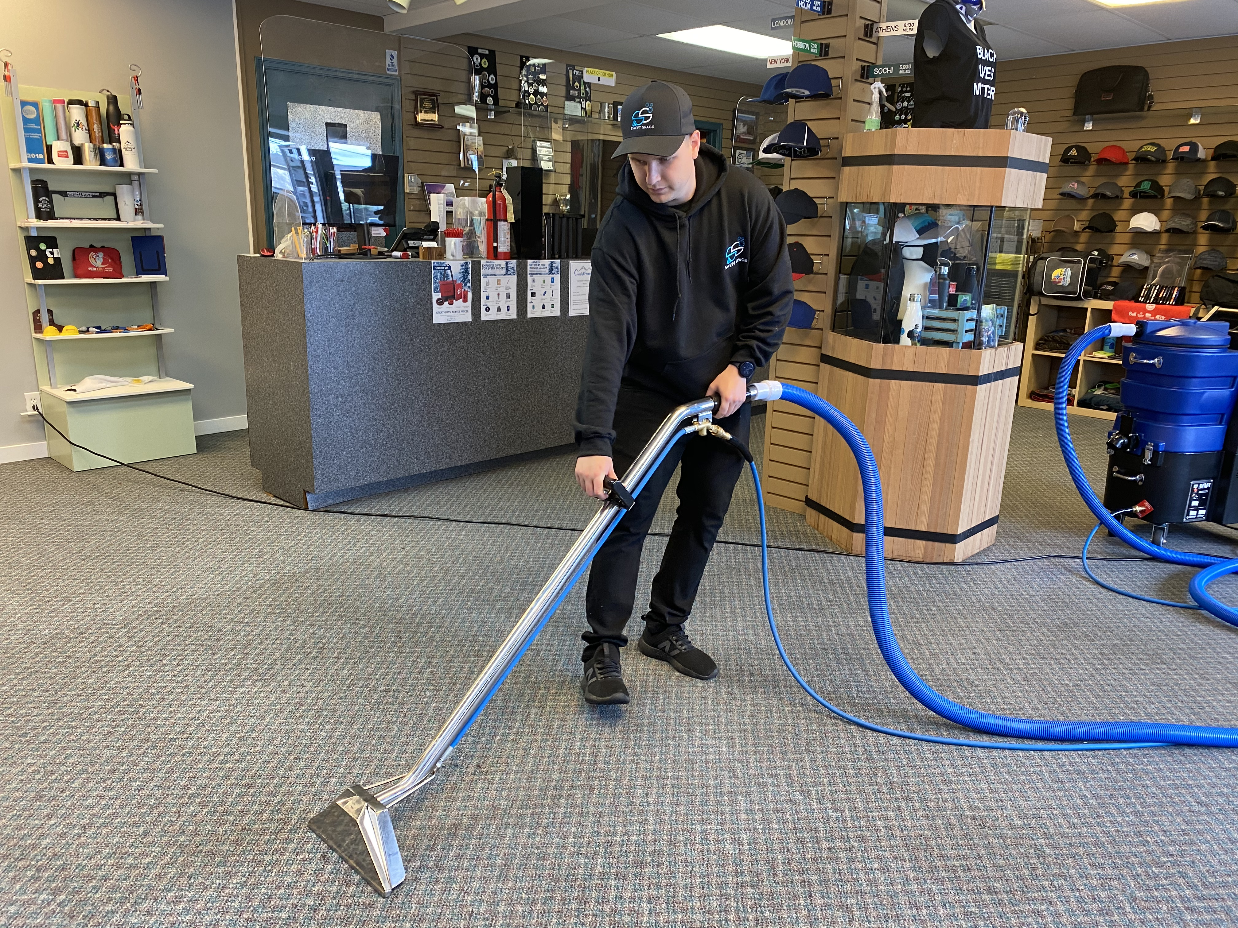 person mopping the floor of an office
